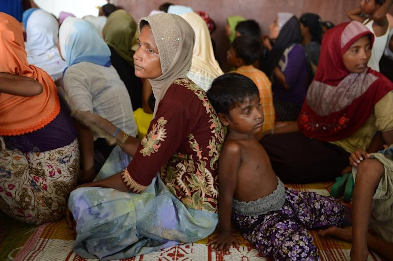Rohingya women and children from Myanmar sit at a new confinement area in Bayeun, Aceh province on May 21, 2015 after being rescued (AFP Photo/Romeo Gacad)