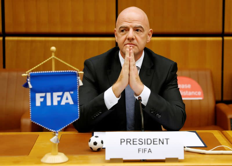 FILE PHOTO: FIFA President Infantino waits for a signing ceremony in Vienna