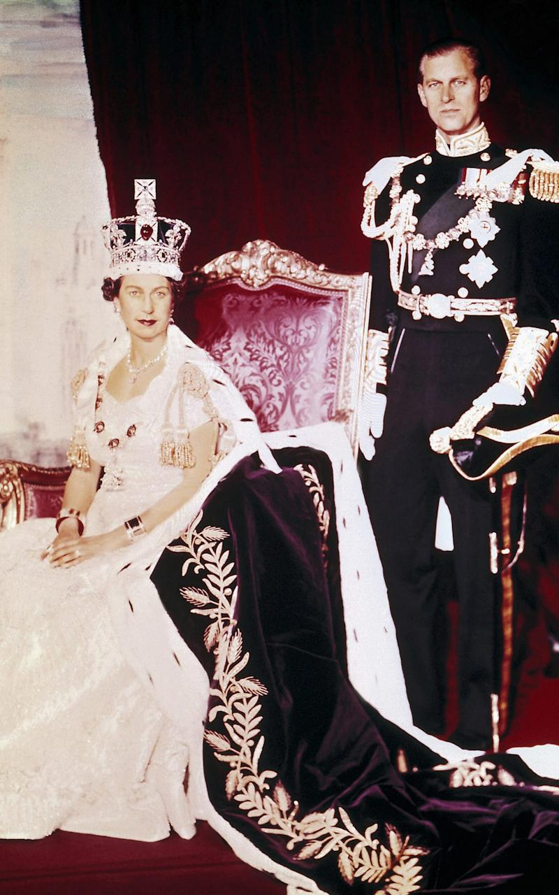 Queen Elizabeth II and the Duke of Edinburgh pose on the Queen's Coronation day - Credit: AFP