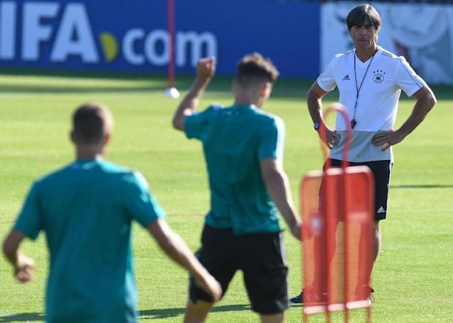 Joachim Loew puts the Germany players through their paces (AFP Photo/Patrik STOLLARZ)