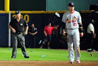 Umpire Rob Drake reacts after bottles and cups are thrown on the field by fans after the home fans disagree with an infield fly ruling on a ball hit by Andrelton Simmons #19 of the Atlanta Braves in the eighth inning while taking on the St. Louis Cardinals during the National League Wild Card playoff game at Turner Field on October 5, 2012 in Atlanta, Georgia. (Photo by Scott Cunningham/Getty Images)