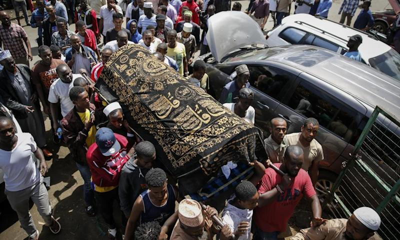 Family members carry the coffin of 13-year-old Yasin Hussein Moyo