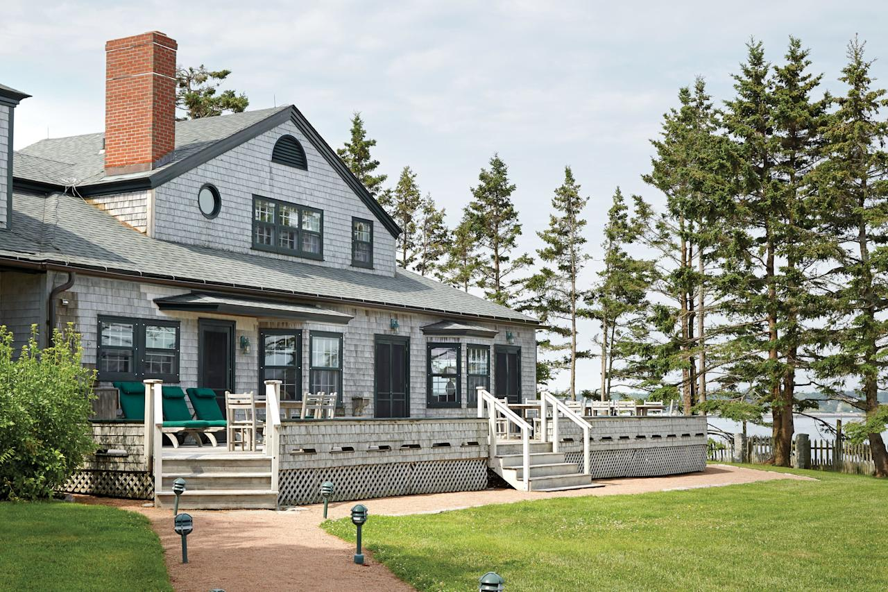 """<p>""""We can't possibly go look at that house. We'll buy it."""" That's what Kathleen McIntyre and her husband, Duncan, told one another when a historic property on Maine's Great Cranberry Island hit the market. The McIntyres, who reside just outside of Boston, had long had a soft spot for the rugged shores surrounding Bar Harbor and Mt. Desert Island, and they'd dreamed of owning a summer home there.</p> <p><i>Pictured: Original details, including the cedar shingles, exude classic New England charm.</i></p>"""