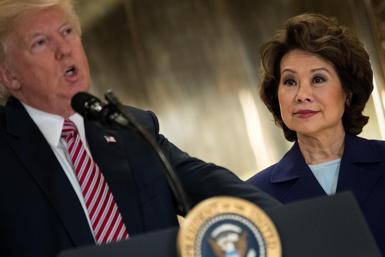 Mitch McConnell's wife, Transportation Secretary Elaine Chao, looks on as President Donald Trump speaks at Trump Tower on Tuesday. (Photo: Drew Angerer/Getty Images)