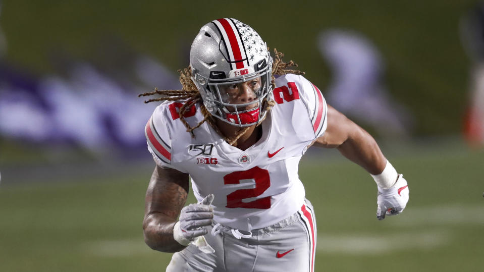 Ohio State defensive end Chase Young rushes the Northwestern quarterback during the second half of an NCAA college football game Friday, Oct. 18, 2019, in Evanston, Ill. (AP Photo/Charles Rex Arbogast)