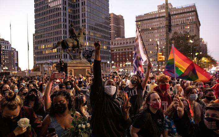 A crowd celebrates in the streets - Chris McGrath/Getty Images North America