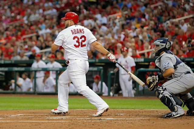 St. Louis Cardinals' Matt Adams follows through on a RBI single during the first inning of a baseball game against the San Diego Padres Friday, Aug. 15, 2014, in St. Louis. (AP Photo/Scott Kane)