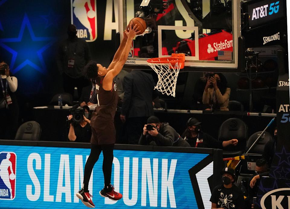 Anfernee Simons of the Portland Trail Blazers competes in the  AT&T Slam Dunk Contest