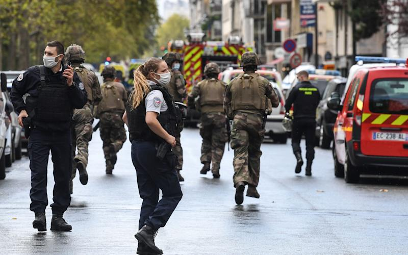 French soldiers were seen rushing towards the scene of the attack - ALAIN JOCARD/AFP