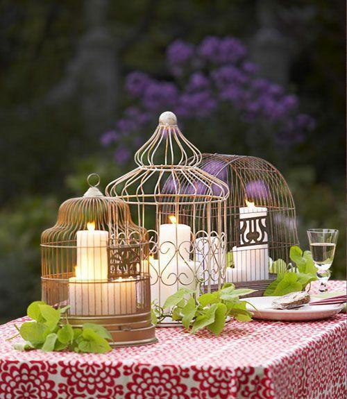 <p>A trio of flea market birdcages serves as a candle-corralling centerpiece, or fill them with flowers like this fanciful arrangement.<br></p>
