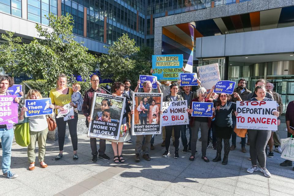 Protesters hold up signs outside Melbourne Federal Court in 2019. Source: Getty