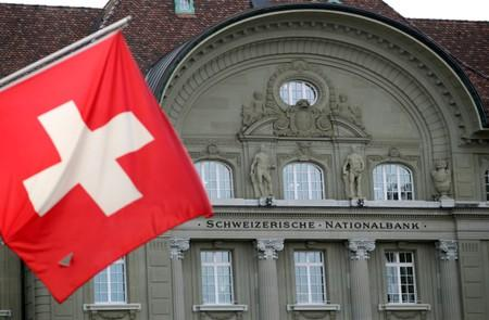 FILE PHOTO: A Swiss flag is pictured in front of the Swiss National Bank (SNB) in Bern