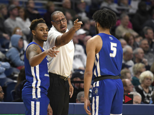 Central Connecticut State coach Donyell Marshall, center, talks with his players Ian Krishnan (3), left, and Xavier Wilson (5) during the first half of an NCAA college basketball game against Penn State, Friday, Dec. 20, 2019, in State College, Pa. (AP Photo/John Beale)