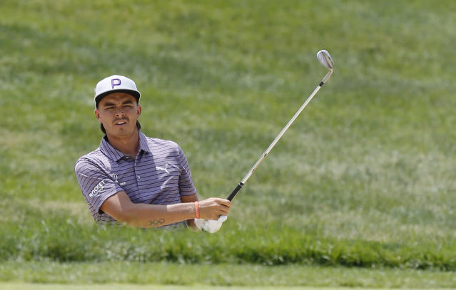 Rickie Fowler hits from the sand on the first hole during the third round of the Memorial golf tournament Saturday, June 1, 2019, in Dublin, Ohio. (AP Photo/Jay LaPrete)