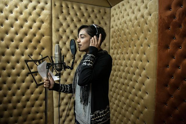 <p>Hadeel Fawzy Abushar 25 records a song in a studio in Gaza City. Few female singers remain as families and local government look down on the practice. Hadeel started when she was 12, as all of her sisters are singers. (Photograph by Monique Jaques) </p>