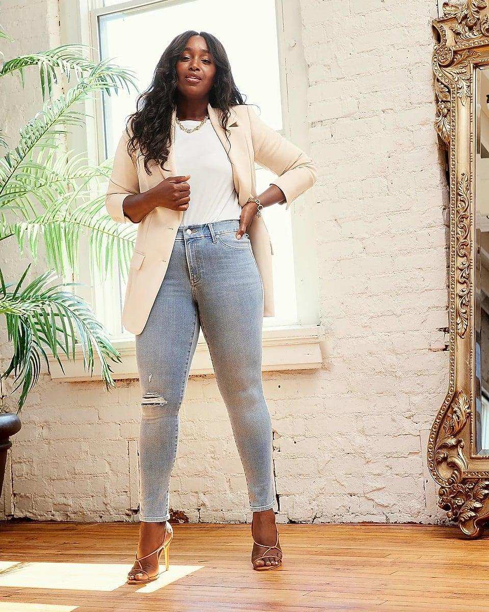 <p>You can't say office wear without a classic <span>Express Supersoft Double Knit Two Button Boyfriend Blazer</span> ($128). It looks crisp, chic, and perfect for people who like to keep their color palette neutral.</p>