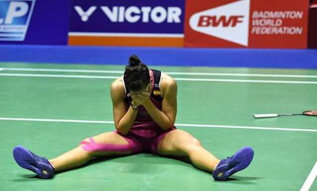 A tearful Marin collapsed to the court floor and buried her head in her hands after powering to victory (AFP Photo/STR)