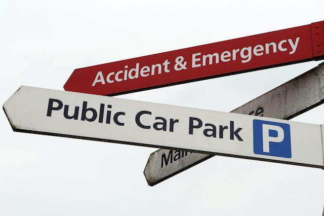 Embargoed to 0001 Thursday December 28 File photo dated 21/05/13 of accident and emergency and public car park signs at a hospital. NHS hospitals made a record £174 million in the last year from charging patients, visitors and staff for car parking, an investigation has found.
