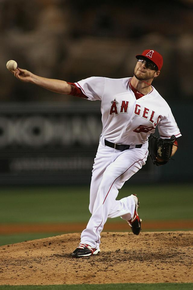 ANAHEIM, CA - JUNE 15:  David Carpenter #52 of the Los Angeles Angels of Anaheim pitches against the Arizona Diamondbacks in the eighth inning at Angel Stadium of Anaheim on June 15, 2012 in Anaheim, California.  (Photo by Jeff Golden/Getty Images)