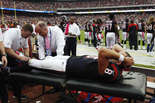 Houston Texans quarterback Matt Schaub (8) is tended to after being injured on a sack by St. Louis Rams' Chris Long during the third quarter of an NFL football game Sunday, Oct. 13, 2013, in Houston, Texas. (AP Photo/Patric Schneider)