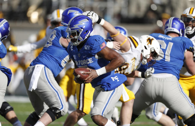 Air Force quarterback Donald Hammond III runs for a short gain against Wyoming in the first half of an NCAA college football game Saturday, Nov. 30, 2019, at Air Force Academy, Colo. (AP Photo/David Zalubowski)