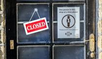 A closed sign next to a social distancing sign in a shop window in Haworth, West Yorkshire (Danny Lawson/PA)