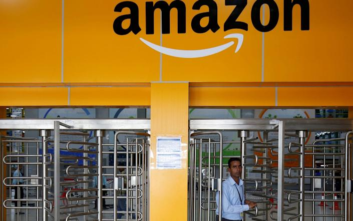 Many Amazon staff who work in warehouses will not be able to work from home - REUTERS