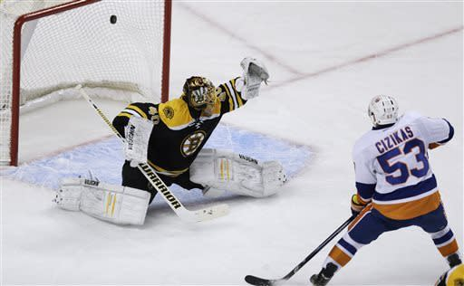 New York Islanders center Casey Cizikas (53) beats Boston Bruins goalie Tuukka Rask (40) for a goal during the first period of an NHL hockey game, Thursday, April 11, 2013, in Boston. (AP Photo/Charles Krupa)