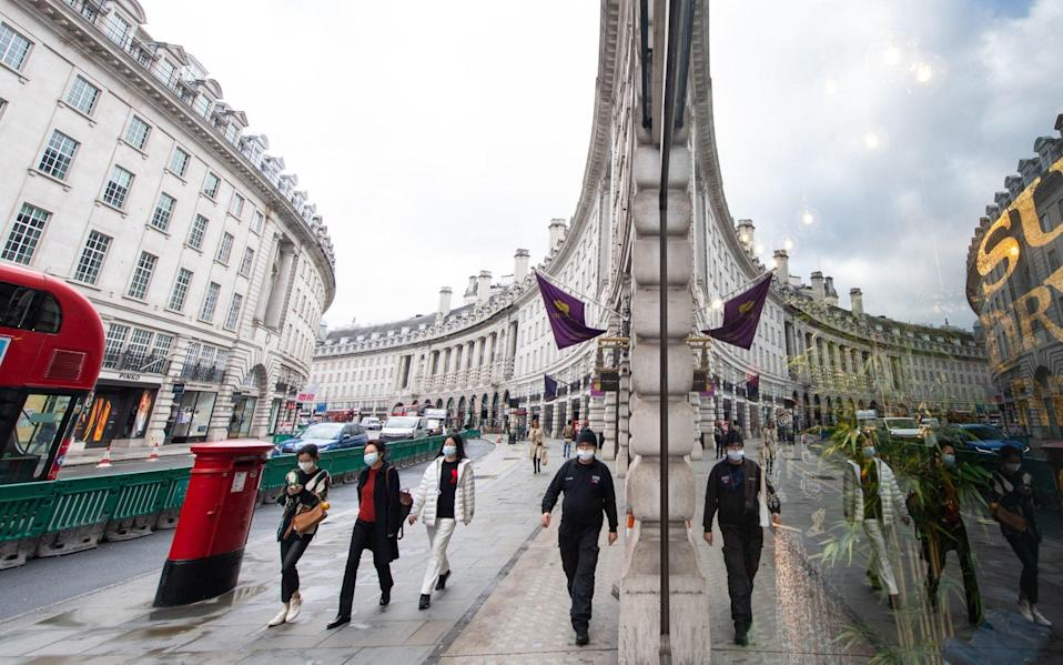 Shoppers wearing protective face masks on Regent Street, London - Dominic Lipinski/PA