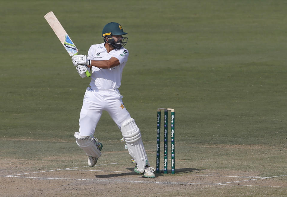 Pakistan's batsman Fawad Alam follows the ball after playing a shot for boundary during the second day of the first cricket test match between Pakistan and South Africa at the National Stadium, in Karachi, Pakistan, Wednesday, Jan. 27, 2021. (AP Photo/Anjum Naveed)