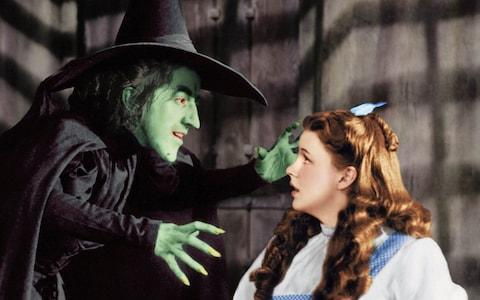 Margaret Hamilton as Miss Gulch/The Wicked Witch of the West and Judy Garland as Dorothy in the film 'The Wizard Of Oz'