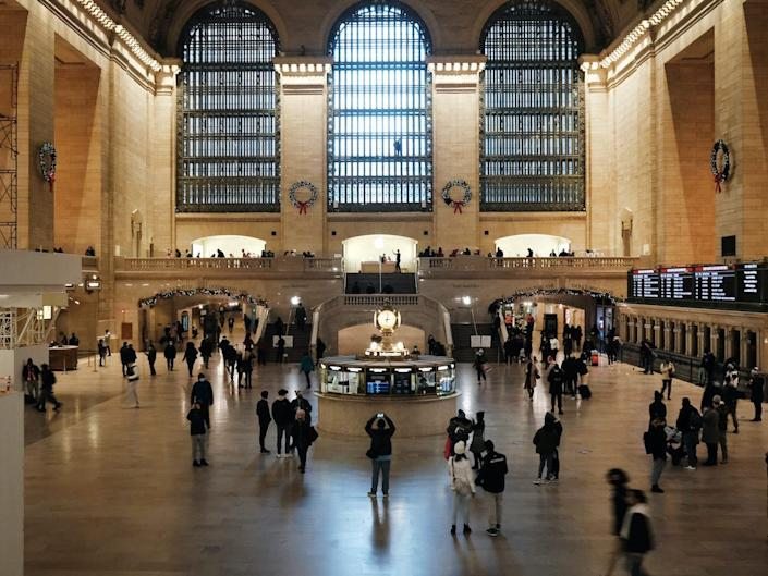 People walk through Grand Central Terminal two days before the Christmas holiday on December 23, 2020