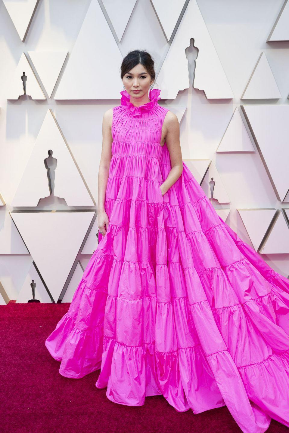 "<p>The <em>Crazy Rich Asians</em> star wore a voluminous Valentino dress with a high collar to the red carpet and landed on the <a href=""https://www.cosmopolitan.com/style-beauty/fashion/a26363626/best-worst-dressed-oscars-2019/"" rel=""nofollow noopener"" target=""_blank"" data-ylk=""slk:best-dressed list"" class=""link rapid-noclick-resp"">best-dressed list</a>. As a bonus, the frock even had pockets!!! </p>"