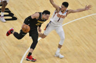 Memphis Grizzlies guard Dillon Brooks (24) drives against Phoenix Suns guard Devin Booker (1) in the second half of an NBA basketball game Monday, Jan. 18, 2021, in Memphis, Tenn. (AP Photo/Brandon Dill)