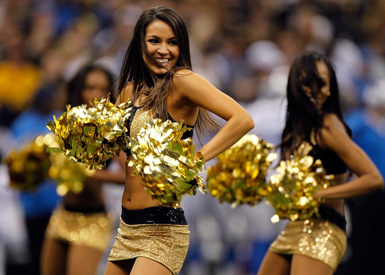 A cheerleader performs during the 2012 NFC Wild Card Playoff game between the New Orleans Saints and the Detroit Lions at Mercedes-Benz Superdome on January 7, 2012 in New Orleans, Louisiana. (Photo by Chris Graythen/Getty Images)