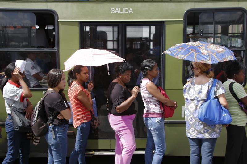 "People wait to get on the bus while the metro is out of service due to a blackout in Caracas, Venezuela, Tuesday, Aug. 20, 2019. The state electricity company reported on Twitter that a ""breakdown"" at an undisclosed location had caused the blackout and all power had been restored within hours, while opposition leader Juan Guaidó told local media that the outage was impacting at least 11 of Venezuela's 24 states. (AP Photo/Leonardo Fernandez)"