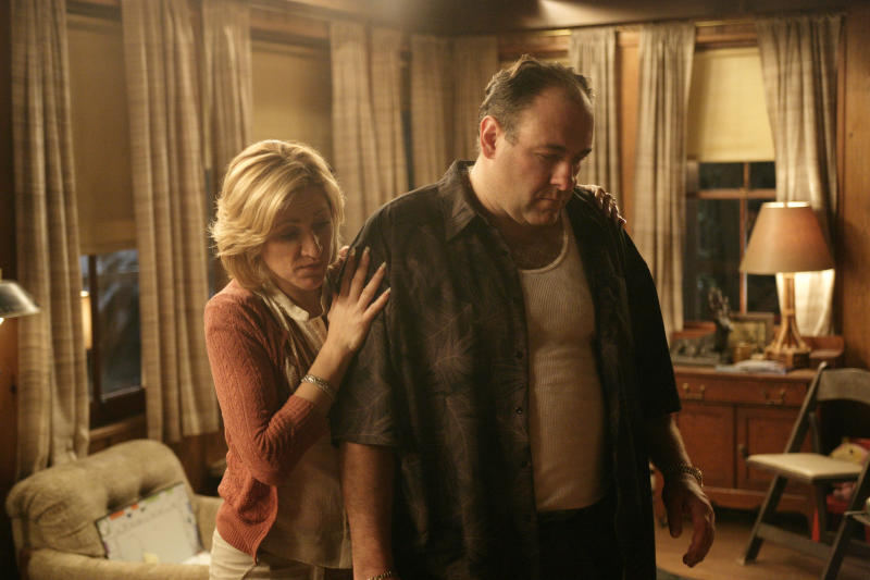 """<p> FILE - In this file photo, originally released by HBO in 2007, Edie Falco portrays Carmela Soprano and James Gandolfini is Tony Soprano in a scene from one of the last episodes of the hit HBO dramatic series """"The Sopranos."""" Amazon is teaming up with HBO, the first such streaming arrangement agreed to by the cable network, in a deal that will make available to Amazon Prime members some classic TV like """"The Sopranos"""" and """"The Wire."""" (AP Photo/HBO, Craig Blankenhorn, File) </p>"""