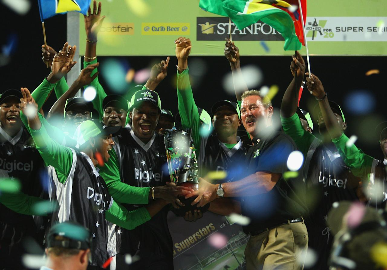 ST. JOHN'S, ANTIGUA AND BARBUDA - NOVEMBER 01: Sir Allen Stanford presents the trophy to Superstars captain Chris Gayle during the Stanford Twenty20 Super Series 20/20 for 20 match between Stamford Superstars and England at the Stanford Cricket Ground on November 1, 2008 in St Johns, Antigua. (Photo by Tom Shaw/Getty Images)