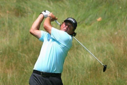 Four-time Major winner Phil Mickelson, pictured on July 6, burst free of a recent form slump with a blistering 64 on day two of the Scottish Open at Castle Stuart on Friday