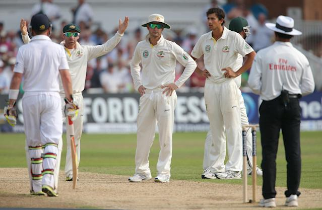 Australia captain Michael Clarke looks to umpire Aleem Dar after catching out England's Stuart Broad for him to be then ruled not out, during day three of the First Investec Ashes Test match at Trent Bridge, Nottingham.
