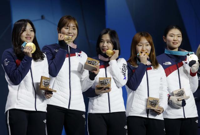 Medals Ceremony - Short Track Speed Skating Events - Pyeongchang 2018 Winter Olympics - Women's 3000 m - Medals Plaza - Pyeongchang, South Korea - February 21, 2018 - Gold medalists Shim Sukhee, Minjeong Choi, Kim Alang and Kim Yejin of South Korea on the podium. REUTERS/Eric Gaillard