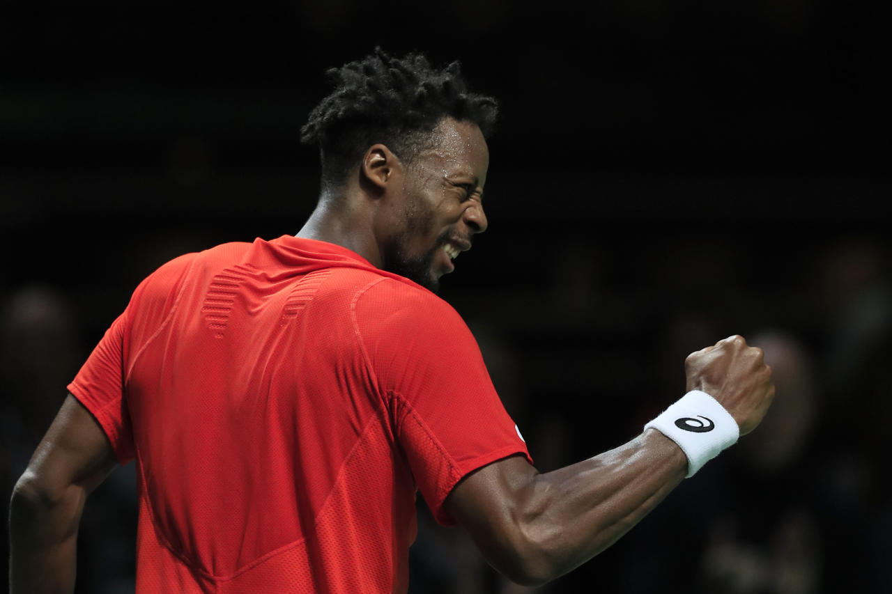 Gael Monfils of France celebrates defeating Daniil Medvedev of Russia in three sets, 4-6, 6-3, 6-4, in the semi-finals of the ABN AMRO world tennis tournament at Ahoy Arena in Rotterdam, Netherlands, Saturday, Feb. 16, 2019. (AP Photo/Peter Dejong)