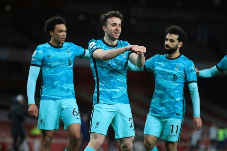 Back in the race: Diogo Jota (centre)opened the scoring as Liverpool beat Arsenal 2-0 to close in on the top four