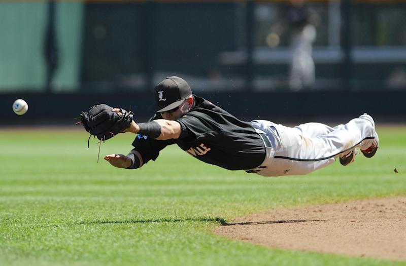 Louisville shortstop Sutton Whiting leaps but cannot reach a two-RBI single hit by Oregon State's Max Gordon in the fourth inning of an NCAA College World Series baseball game in Omaha, Neb., Monday, June 17, 2013. Oregon State's Ryan Barnes and Kavin Keyes scored on the play. (AP Photo/Eric Francis)