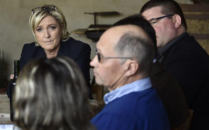 French far-right Front National (FN) party candidate for the presidential election Marine Le Pen looks on during a visit to a farm in Loubersan, southern France - Credit: PASCAL PAVANI/AFP/Getty Images