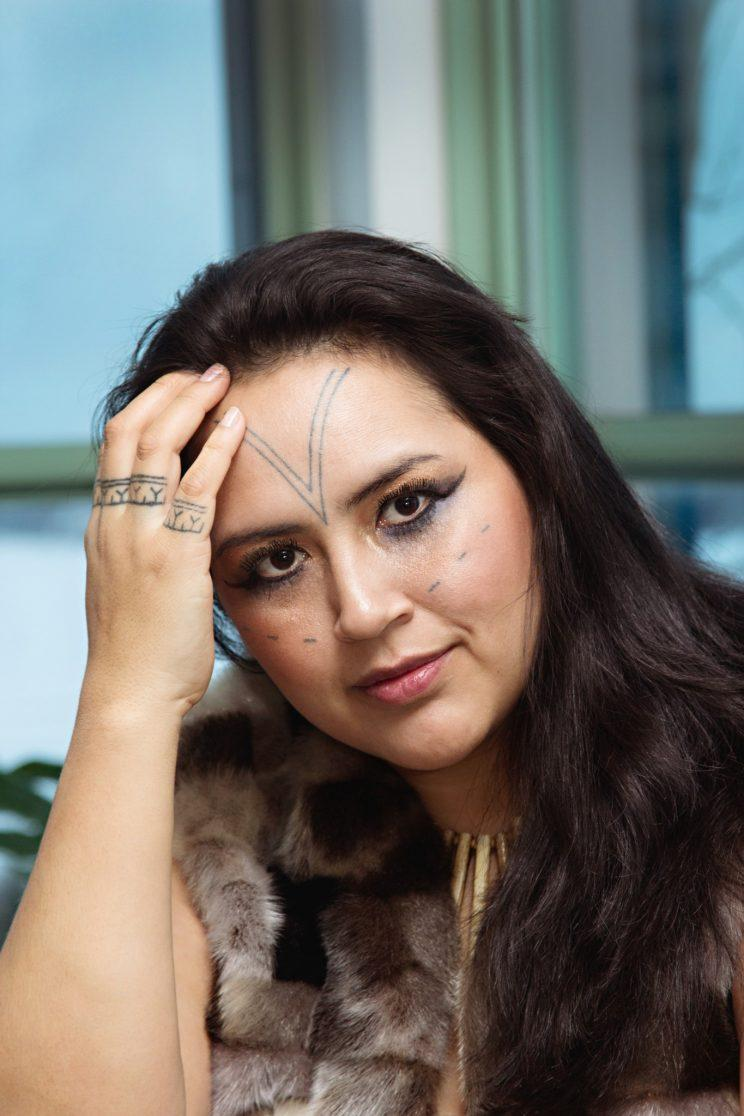 """<p>Yellowknife resident Hovak Johnston created the Traditional Inuit Tattoo Project: """"The three slits on my cheeks represent my three children."""" Photo from Cora DeVos/Little Inuk Photography</p>"""