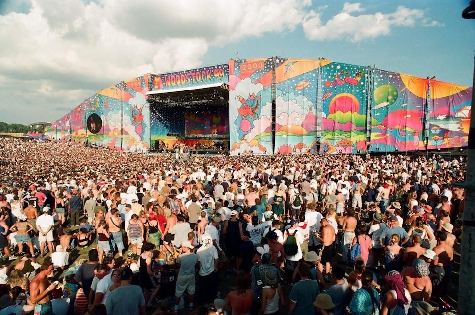 A throng of people gather at one of the festival's stages. Estimates of attendees range from 225,000-400,000.