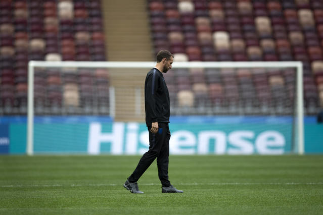 England head coach Gareth Southgate walks along the pitch after England's official news conference on the eve of the semifinal match between England and Croatia at the 2018 soccer World Cup in the Luzhniki stadium in Moscow, Russia, Tuesday, July 10, 2018. (AP Photo/Francisco Seco)