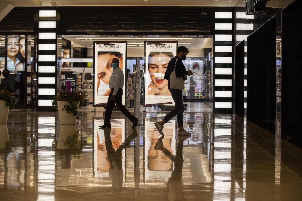 COSTA MESA, CA - SEPTEMBER 28:  Amid Gov. Gavin Newsoms current red-tier restrictions, shoppers are allowed to reach at a maximum of 25% capacity while shopping at South Coast Plaza on Monday, Sept. 28, 2020 in Costa Mesa, CA. OC may be moving up to the Orange tier as early as Tuesday. Moving up to the orange tier means retail businesses could operate at full capacity, instead of 50% in the current red tier. Shopping malls also could operate at full capacity, but with closed common areas and reduced food courts just as in the red tier. The orange tier boosts capacity for churches, restaurants, movies, museums, zoos and aquariums from 25% capacity to half capacity. Gyms and fitness centers could boost capacity from 10% to 25% and reopen pools. Most boutiques and all department stores are open for shopping. South Coast Plaza is billed as the largest shopping center on the West Coast with 250 boutiques, 30 restaurants and sales of over $1.5 billion annually, the highest in the U.S. (Allen J. Schaben / Los Angeles Times via Getty Images)