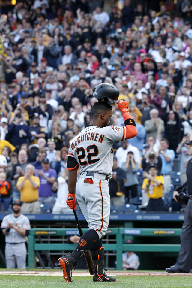 San Francisco Giants' Andrew McCutchen acknowledges fans during a tribute to his years with the Pittsburgh Pirates before his first at-bat in the first inning of a baseball game in Pittsburgh, Friday, May 11, 2018. Pirates starting pitcher Jameson Taillon struck out McCutchen. (AP Photo/Gene J. Puskar)